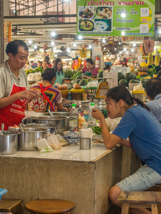 food stall inside local market in chiang mai thailand