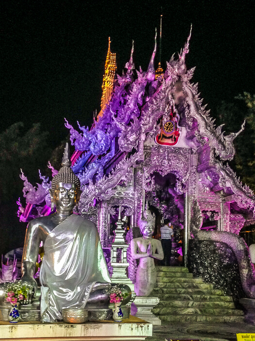 temple lit up at night purple in chiang mai