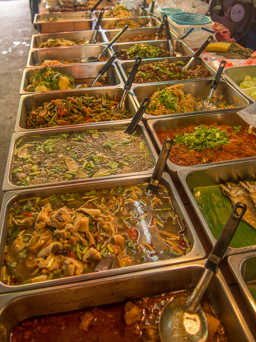 countless curries at the Saturday Night Market in Chiang Mai Thailand
