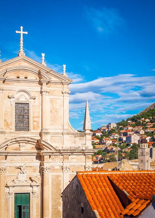 cityscape blue skies church dubrovnik croatia